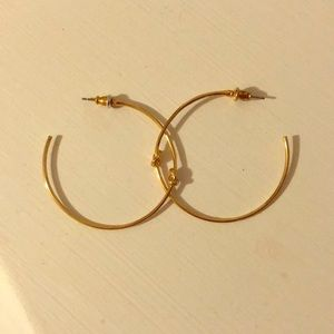 Stella and Dot Gold hoop knitted earrings.